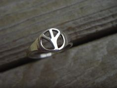 Peace sign ring in sterling silver. $14.00, via Etsy.