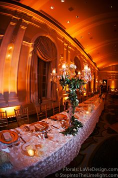 Head table centerpieces were crystal candelabra with garland wrap