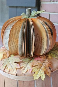 projects / Beautiful fall and halloween decor — pumpkin made from upcycled book pages!