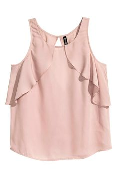 Wide-cut, sleeveless blouse in woven fabric. Ruffles at front and at back, low-cut V-neck at back, and button at back of neck. Stylish Dress Designs, Stylish Dresses, Crop Top Outfits, Skirt Outfits, Low Cut Dresses, Looks Plus Size, Clothing Hacks, Blouse Online, Chiffon Tops
