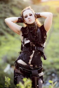 Black fabric, safety pins, and belts