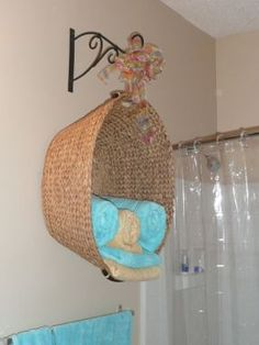 Old Laundry Basket Used For Towel Storage or another pin simply had three baskets of different sizes hanging on the wall, one above the other, without the iron bracket.