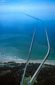 Virginia - Chesapeake Bay Bridge and tunnel is 17.6 miles long including two tunnels that are 1 mile each. It extends out into the bay and Atlantic Ocean connecting the mainland to the eastern coast. It is amazing.