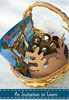 Creating a Book Basket with Holiday books.  Features reindeer learning activity and play from The Educators' Spin On It