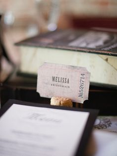 Cut a small slit in a wine cork and use it as a crafty place card holder.
