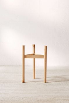 Shop Henrik Wood Dowel Plant Stand at Urban Outfitters today.