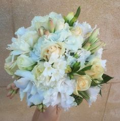 Bridal Bouquet with White Hyacinths, and Lissianthus created by Sweet Floral