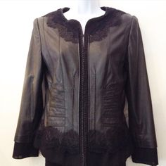 Barbara Bui leather jacket with lace detailing and silk trim on sleeve. Size Small. Please call (949)715-0004 for inquiries.