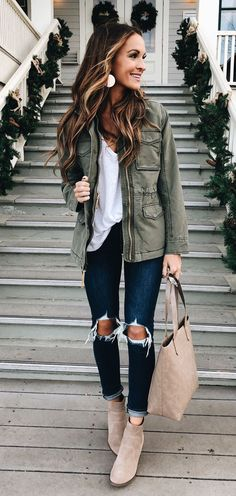 #winter #outfits women's gray leather zip-up jacket, white shirt, distressed blue denim capri pants, brown suede booties, grey shoulder bag screenshot. Click To Shop This Look.