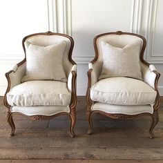 Handsome pair of wood carved bergeres in oatmeal linen coming soon. Handsome pair of wood carved bergeres in oatmeal linen coming soon. Source by