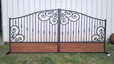 This custom gate is handcrafted in our shop in Texas. This gate has tall sides arching to center. This gate is built for a 14 ft opening. & sizes available upon request& Rough cut cedar planks at the bottom. Wooden Garden Gate, Metal Garden Gates, Metal Gates, Wooden Gates, Wrought Iron Driveway Gates, Front Gate Design, Custom Gates, Entrance Gates, Cedar Planks