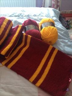 This is gonna happen~Gryffindor scarf, double knit, 3mm circular needles. Pattern: 30 rows red, 5 rows yellow, 5 rows red and 5 rows yellow, repeat until desired length.