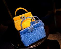 I think these exotic Isabella Rossellini x Bulgari top handle bags can give the Hermes croc kellys a run for their money