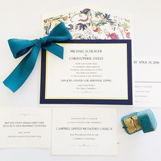 Turquoise and black invitation with decorative and colorful envelope.  Picture By: Van Tran  email: vanvtran2020@gmail.com
