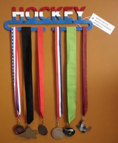Sports Metal Medal Hanger that says Hockey by MetalMedalHangers, $20.00  Need one with GotWind or Sailing or Sailor