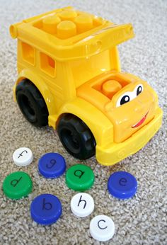 School Bus ABC Game...use a bus toy or make your own to practice letters and sounds with this fun game! Inspired by the book School Bus by Donald Crews.