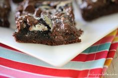 Gooey Cookies and Cream Bars ~ Cake mix, Oreos, sweetened condensed milk, chocolate chips. These are unbelievable! Over the top baking ideas   ~ This bar is just that…over the top and decadent.  With just a few simple pantry ingredients, you'll have this fun recipe staring right at ya, lol!  My mom and I whipped this together last week and we are glad we did.  Chocolate overload!