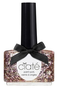 Using this rose gold glitter polish for a fabulous manicure.
