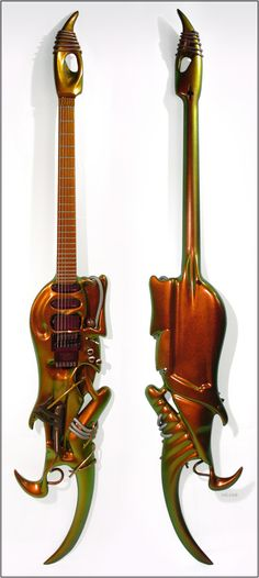 "The ""Ultra Zone"" Guitar    Featured at the 2003 NAMM show and originally built in 2001 by luthier Alistair Hay of Emerald Guitars in Ireland, this guitar is a replica of the strange biotech creation featured on the cover of The Ultra Zone."