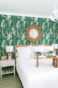 This white and neutral bedroom stands out with the statement wall of pink and green palm fronds. A tropical getaway for a master bedroom. #masterbedroom #interiordesign #wallpaper #wallpaperinspiration Living Area, Living Spaces, Living Room, Pink Velvet Couch, Home Design Magazines, Charleston Homes, House Deck, Inspirational Wallpapers, Contemporary Interior Design