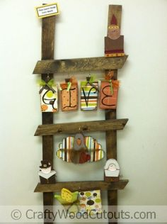 """Unfinished Monthly Ladder Kit Wood Craft. This craft is about 59"""" x .75"""" x 20"""" and costs $19.99. The ladder is not included."""