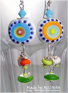 I design and create one of a kind, original, FUNKY Glass beads integrated with a 3 dimensional room for art and always in my shiny happy colors.