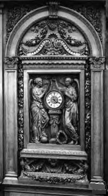 Hand carved mahogany clock on the staircase.