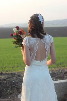 Love the back and the shoulders; the way the lace opens in the front of the skirt is a little too casual.