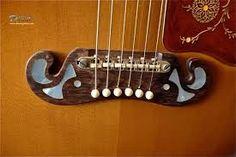 Resultado de imagen para carved guitar bridge acoustic