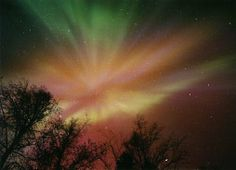 A rare multicolored auroral corona burst over Fairbanks, Alaska on Nov. 7, 1998 and was preserved for posterity in a three-second exposure by Jan Curtis. www.KaleidoscopeSky.net