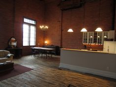 One of the reasons we bought this building was because of this beautiful space, with its 20' high wood ceiling. It was originally designed as a carpet drying room when the building was built in 1929. It is now our kitchen, dining, living area...