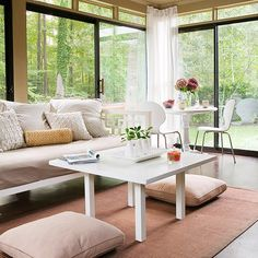 Nothing will brighten your home so much as sparkling clean windows inside and out. Open windows to let in springtime breezes, and invite the outdoors in with unobstructed views into the garden. In this family room, bright white furnishings add another breath of fresh air. Even bringing in one eye-catching piece of white furniture, like the coffee table here, will give any room a springlike feel./