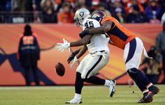 Malik Jackson (97) of the Denver Broncos knocks the ball away from Marcel Reece (45) of the Oakland Raiders during the third quarter.  The Denver Broncos
