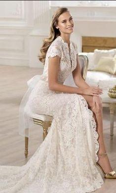 Pronovias Yanguas 12: buy this dress for a fraction of the salon price on PreOwnedWeddingDresses.com