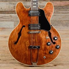 """Today's #werenotworthy goes out to this wonderful shot from @reverbdotcom """"When it comes to the Gibson ES-335's finishes Cherry Red seems to be the most instantly recognizable  made iconic by players like Eric Clapton and Alvin Lee. But the Walnut finish on this ES-335 is certainly giving red a run for its money."""" 