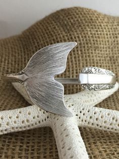 A personal favorite from my Etsy shop https://www.etsy.com/listing/226957203/sterling-silver-mermaid-tail-spoon