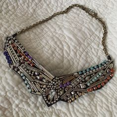 Statement necklace. Statement necklace. A mix of silver and gold, colored with orange, yellow, blue and purple stones. Worn a couple of times, string is a little worn out as seen in the picture, however it can be easily replaced. No trades, sorry. Jewelry Necklaces