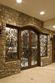 Wine cellar addition to home with beautiful doors.