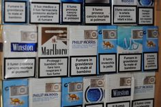 The door of my wardrobe is covered with packs of cigarettes
