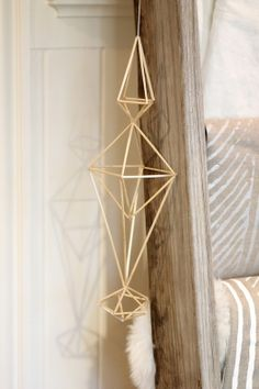 Minimalist straw Himmeli Mobile from AM Radio for a rustic, boho chic kid's room