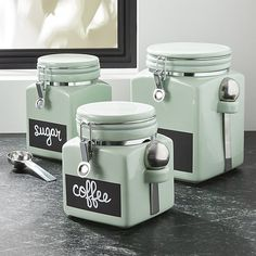 Pistachio green adds a fun retro feeling to these canisters outfitted with a chalkboard strip to label contents. Made of stoneware, the canisters have an airtight clamp closure to ensure freshness and a convenient stainless steel scoop.