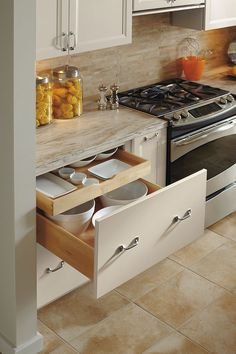 Deep Drawer Base Cabinet with Roll Out Our Deep Drawer Base Cabinet has a combination of generous drawer below and a sliding roll tray above to do double duty on storing your items.