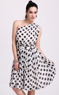 White chiffon dress with black polka dots. One shoulder only.