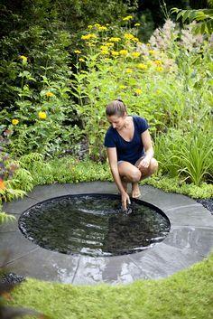 circular stone water mirror for the garden from www.pithandvigor.com