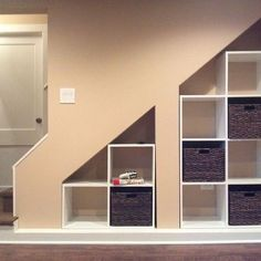 Built in shelves under stairs furniture wood built in cabinet under basement stairs with rattan basket . built in shelves under stairs Basement Storage Shelves, Home, Built In Cabinets, Basement Stairs, Staircase Storage, Rec Room Basement, Basement Decor, Remodel Bedroom, Basement Storage