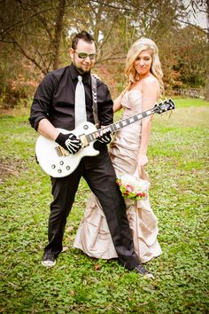 Bride and Groom with guitar.  Groom is lead guitarist in a band