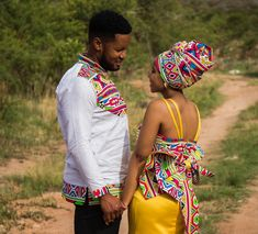 Image may contain: 2 people, people standing and outdoor Couples African Outfits, Couple Outfits, African Attire, African Dress, African Clothes, Traditional African Clothing, African Traditional Wedding, Traditional Wedding Dresses, African Print Fashion