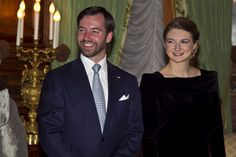 Hereditary Grand Duke Guillaume and Hereditary Grand Duchess Stéphanie smiled while waiting for Francois Hollande.