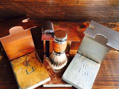 "Hand-Made Brush and Razor Stands.  Stainless Steel, Copper, and Heat Colored Copper (heat coloring the copper brings out warm purples, blues and reds in the copper).  Our hand-made brush and razor stands are milled in our local shop. The stands come in two sizes, 1"", fitting our Americano and Just Joe Shave Brushes, and 1.25"", which fits our Dopio Shave Brush. Each stand features a unique etched stone base, giving the stand a natural look, while providing stability. #shaveyourmug"