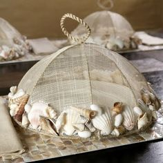 Anything can be embellished with seashells. Browse Completely Coastal for hundreds of ideas: http://www.completely-coastal.com/search/label/Shell%20Crafts